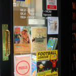 posters for events and clubs in Waterstones bookshop window by Amy Hopwood