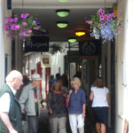 shoppers in Antelope Walk by Amy Hopwood